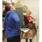 Woman picking supplies at a food bank