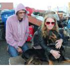 Roy and Debbie Osmond, with their dog Caesar, pack up their belongings on the path near Victoria's Reeson Park