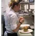Worker with a hamburger on a plate