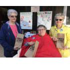 United Church Women members marked International Day for the Eradication of Poverty by handing out Chew on This! lunch bags in downtown Woodstock