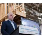 Quebec Premier Philippe Couillard discussing his government's $3-billion action plan to fight poverty