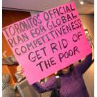 Protester holding a sign at Toronto City Hall