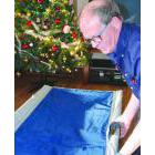 Roger Evans makes up a cot at Compass House