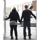 Kayte and Matt stand in an entranceway at the Guelph Community Health Centre in early April