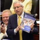 Ontario Finance Minister Vic Fedeli presents the 2019 budget as Premier Doug Ford looks on at the legislature in Toronto on Thursday, April 11, 2019