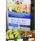 Fresh food in front of a poster promoting healthy eating