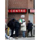 Men gather outside of a shelter in downtown Toronto on Saturday, March 28, 2020