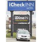 Sign identifying the iCheck INN motel