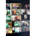 Bank of TV screens showing County Councillors' virtual meeting