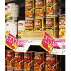 Cans of soup on a rocery store shelf