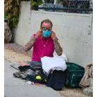 Homeless person with a mask on