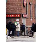 People waiting outside The Salvation Army Maxwell Meighen Centre in Toronto