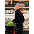 A women overlooks produce in a grocery store in Toronto